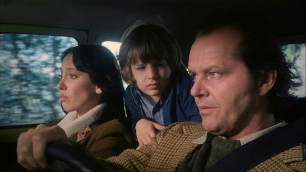 Jack, Wendy, and Danny in the car