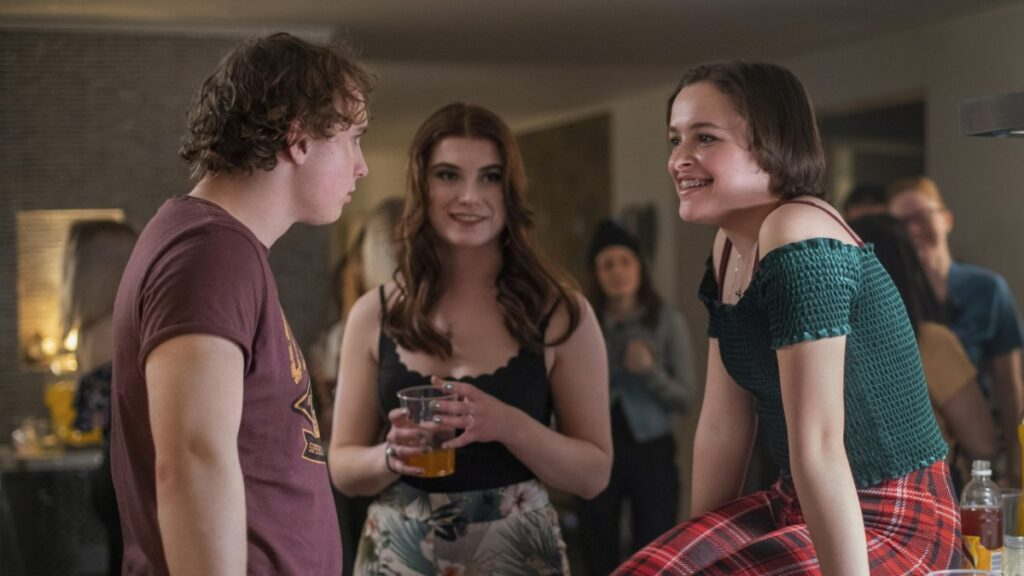 Beartown: Oliver Dufåker as Kevin talking to Miriam Ingrid as Maya at a house party