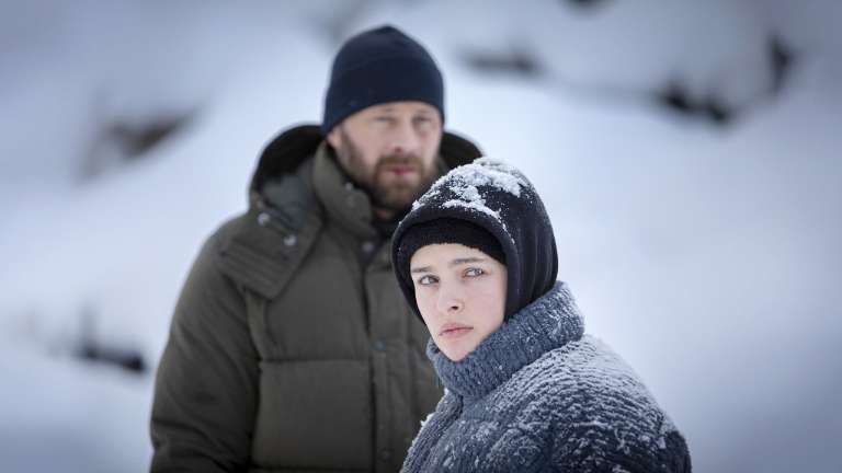 Beartown: Ulf Stenberg as Peter and Miriam Ingrid as Maya standing in the snow